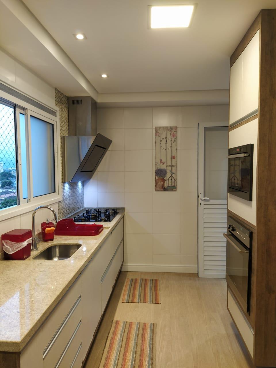 Embaré amplo apartamento com 3 dormitórios, sendo uma suite , ótima sala para 2 ambientes com varanda gourmet - foto 16