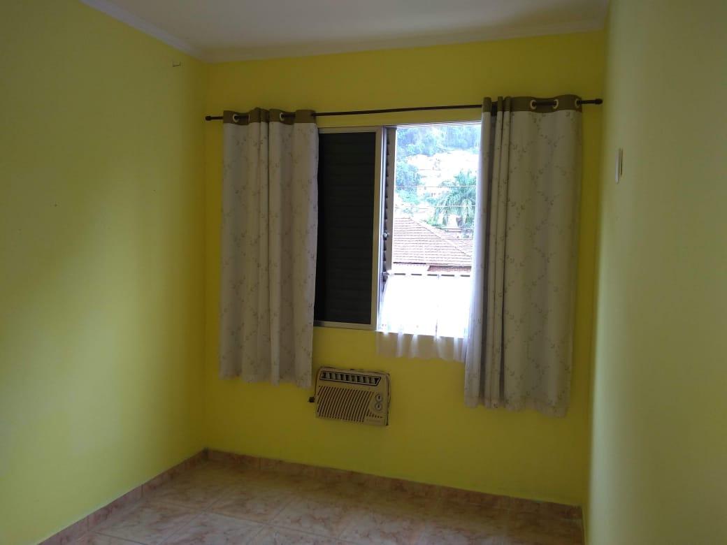 Vendo marapé apartamento 2 dormitórios  muito bem acabado com decoração em gesso 3 D na sala de dois ambientes - foto 9