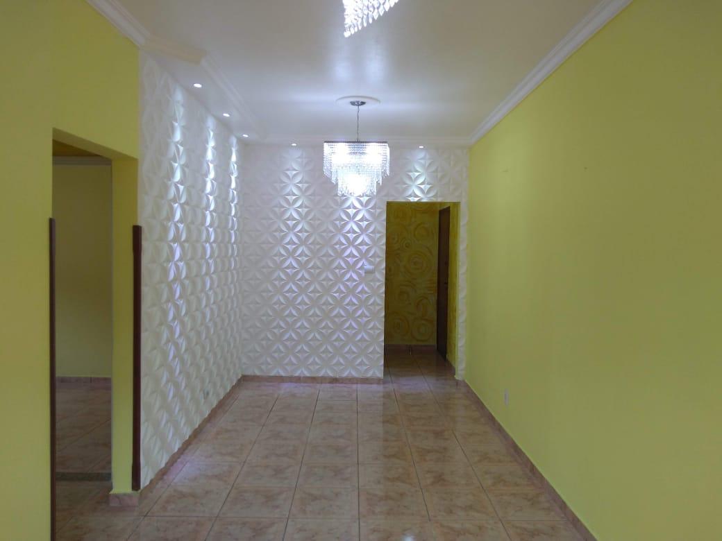 Vendo marapé apartamento 2 dormitórios  muito bem acabado com decoração em gesso 3 D na sala de dois ambientes - foto 8