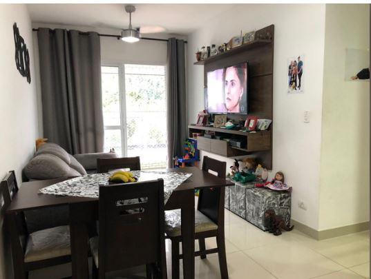 Seminovo apartamento de 2 dormitórios com pisos em porcelanato, sala 2 ambientes - foto 1